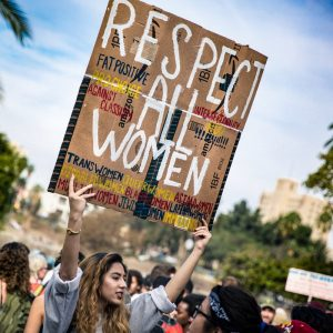 Photo of protesters with Respect all women placard
