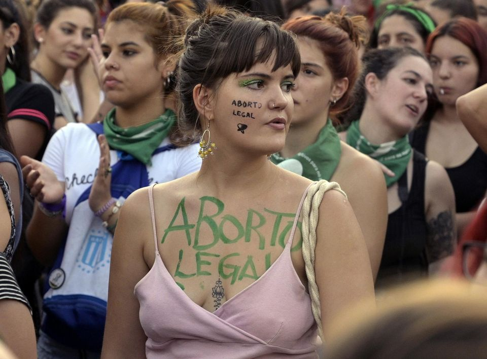 Photo of woman with Abortion Legal written on their body