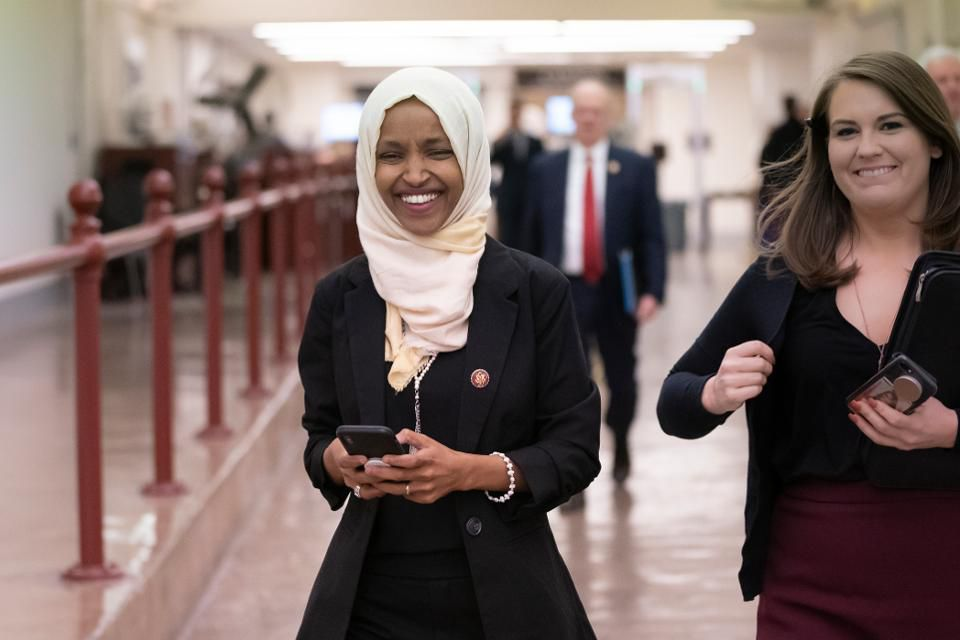 "Rep. Ilhan Omar, D-Minn., walks to the chamber Thursday, March 7, 2019, on Capitol Hill in Washington, as the House was preparing to vote on a resolution to speak out against, as Speaker of the House Nancy Pelosi said, ""anti-Semitism, anti-Islamophobia, anti-white supremacy and all the forms that it takes,"" an action sparked by remarks from Omar. (AP Photo/J. Scott Applewhite) ASSOCIATED PRESS"
