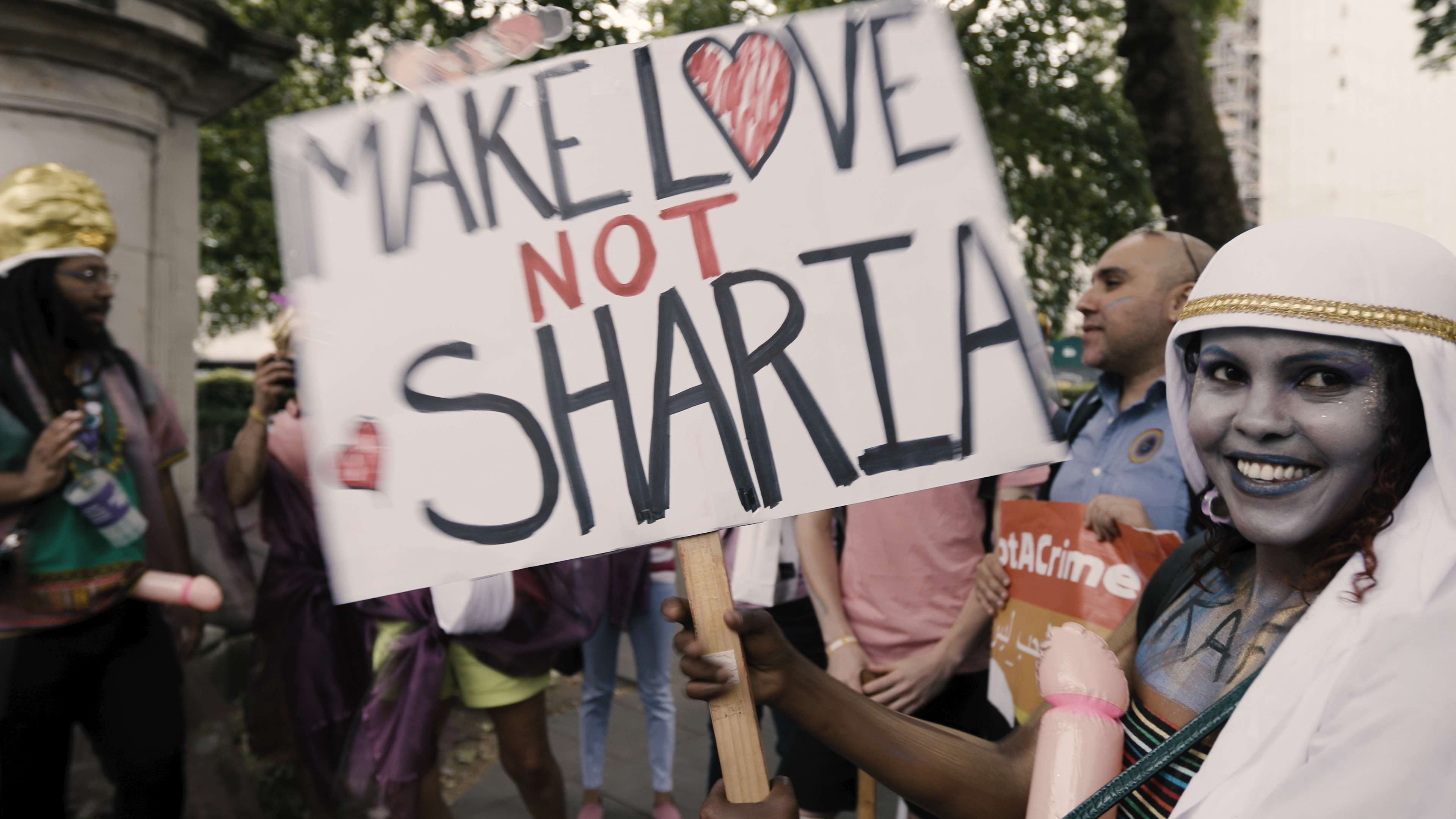 London Pride photo with banner make love not sharia